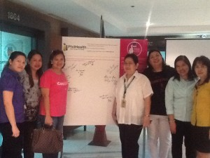 ICanServe volunteers deliver the Pink Positive Pledge Wall to PhilHealth, a staunch partner for early breast cancer detection. (September 30, 2013)