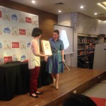 Lisa Gokongwei-Cheng present Lea Salonga with a framed Princess Lea book cover