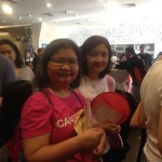 ICanServe volunteers Carla Paras-Sison and Tina Gutierrez in queue for book signing