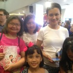 ICanServe volunteers Carla and Tina with TV host Daphne Osena, also in queue with her three daughters for the book signing