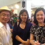 Journalist Norman Sison, congresswoman Leni Robredo and the President's sister Viel Aquino-Dee queue up for the book signing