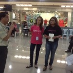 Philhealth representative talks about the Z-benefit package as Kara Alikpala (ICanServe co-founder) and Trina Biazon (head of Muntinlupa GDO) listen